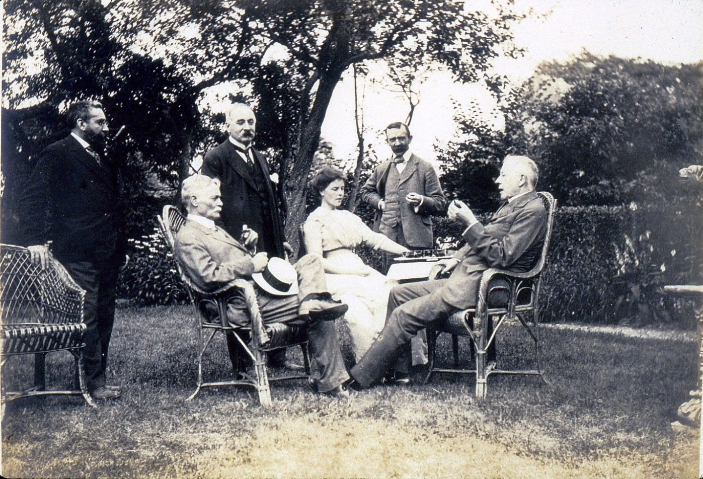 Charles, Catalan artist Ramon Casas, and several friends socializing outdoors ca. 1910s