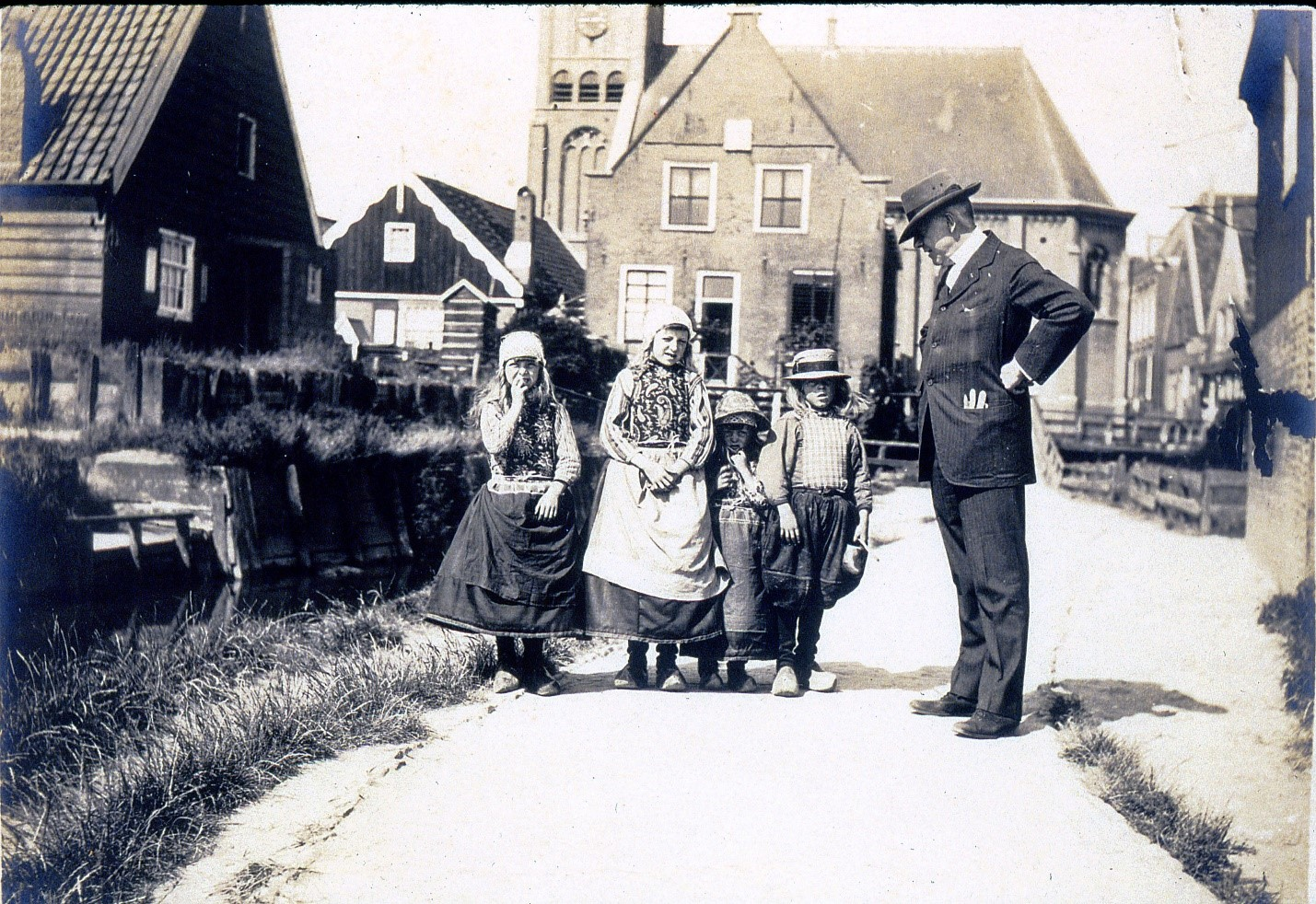Charles Deering posing with local children in the Netherlands during one of his European travels ca. 1910s