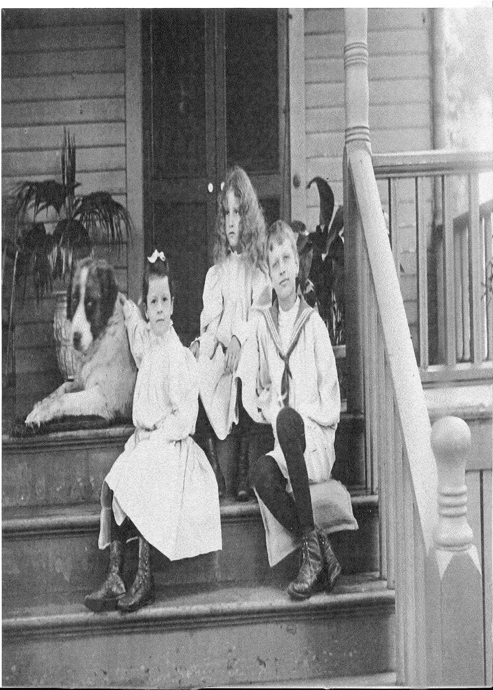 Charles and Marion Deering's children Barbara, Marion Jr., and Roger with family dog in Evanston, Illinois home ca. 1890s