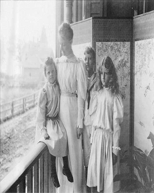 Marion Denison Whipple Deering (1857-1943) with children Barbara, Roger, and Marion Jr. at their Evanston, Illinois home ca. 1890s
