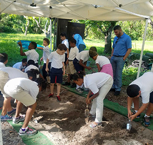 Students conducting a mock archaeology dig as part of the NESTT program