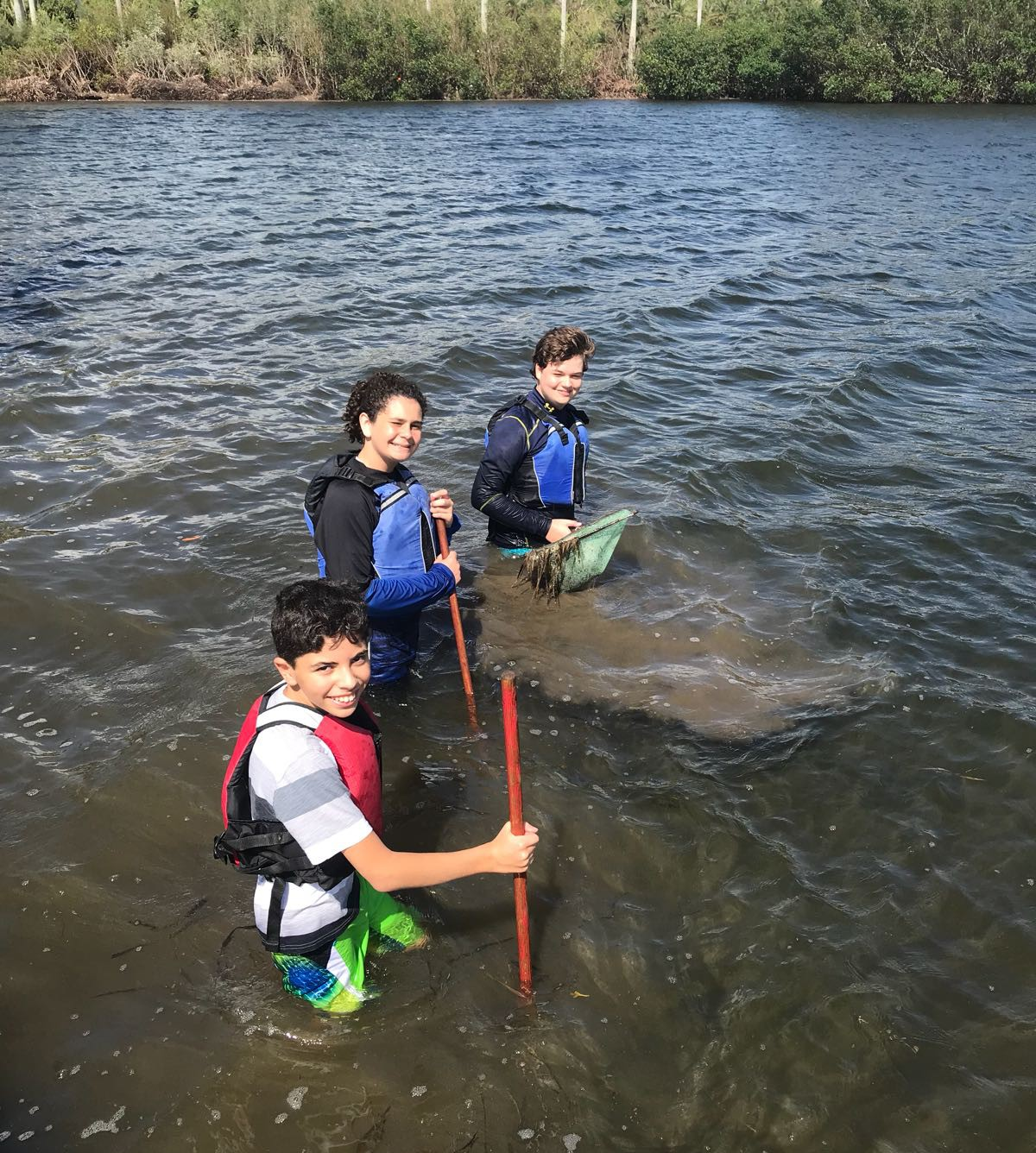 students conducting a catch and release of marine life in Biscayne bay