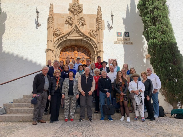Group of Deering Estate Foundation members standing in front of the Palau de Maricel in Spain