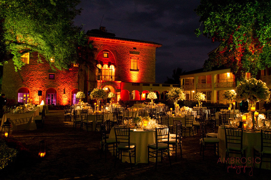 deering estate courtyard set up for a wedding celebration with custom lighting around historic stone house