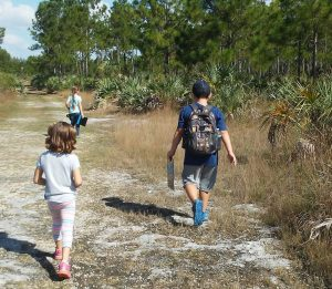 students on a hike through the endangered pine rocklands