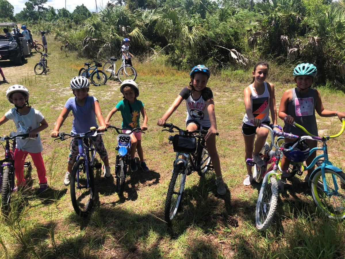 Campers biking through Deering Pine rockland eco system.