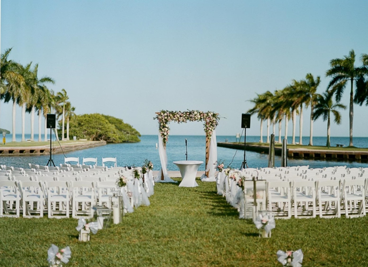 a wedding ceremony setup on the front lawn including an altar and chairs