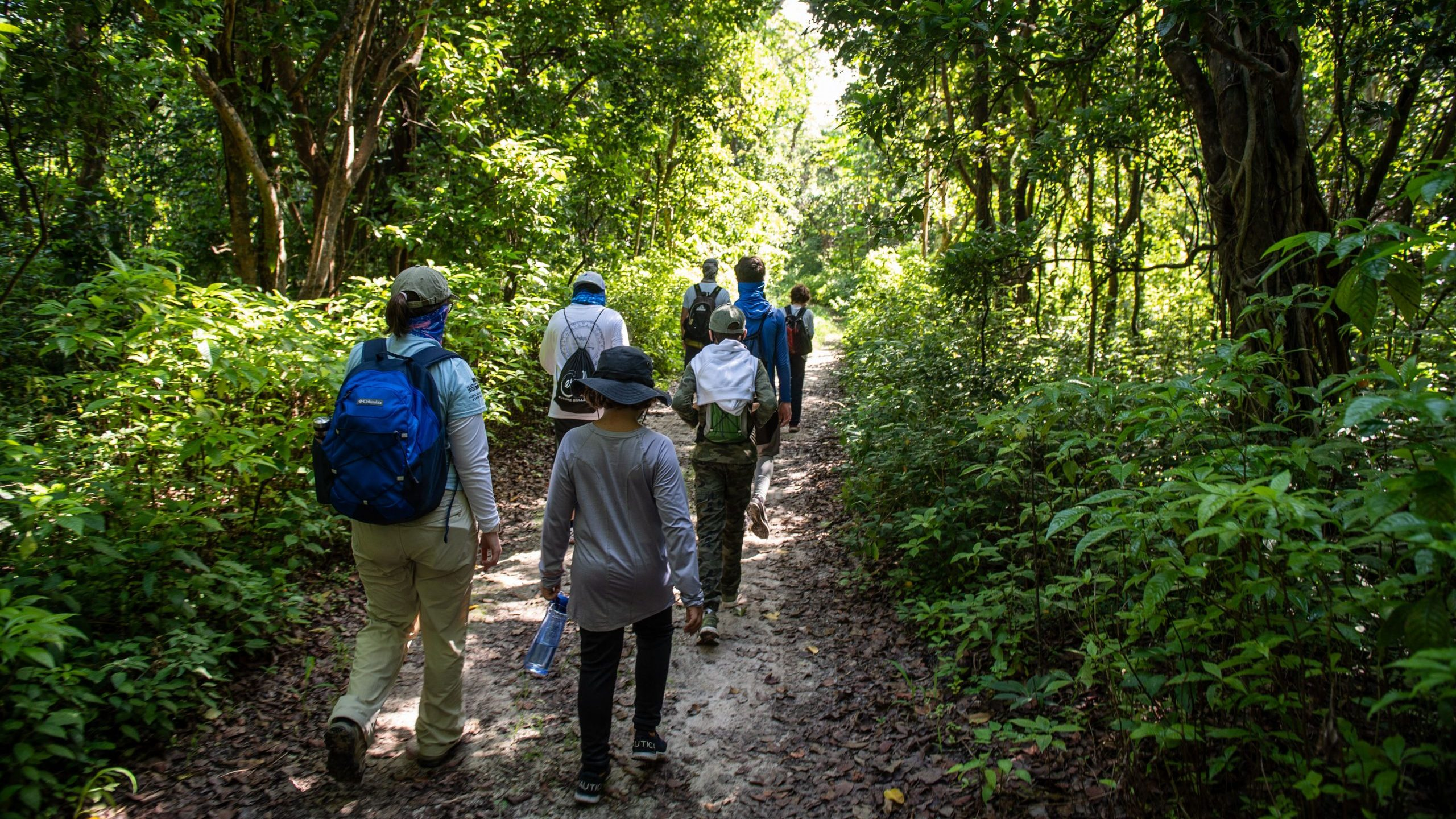 Small group of campers hiking through the Deering Estate Nature Preserve