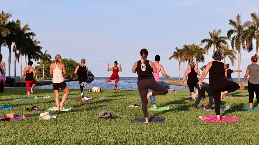 Small group on the main lawn participating in the Full Moon Yoga event