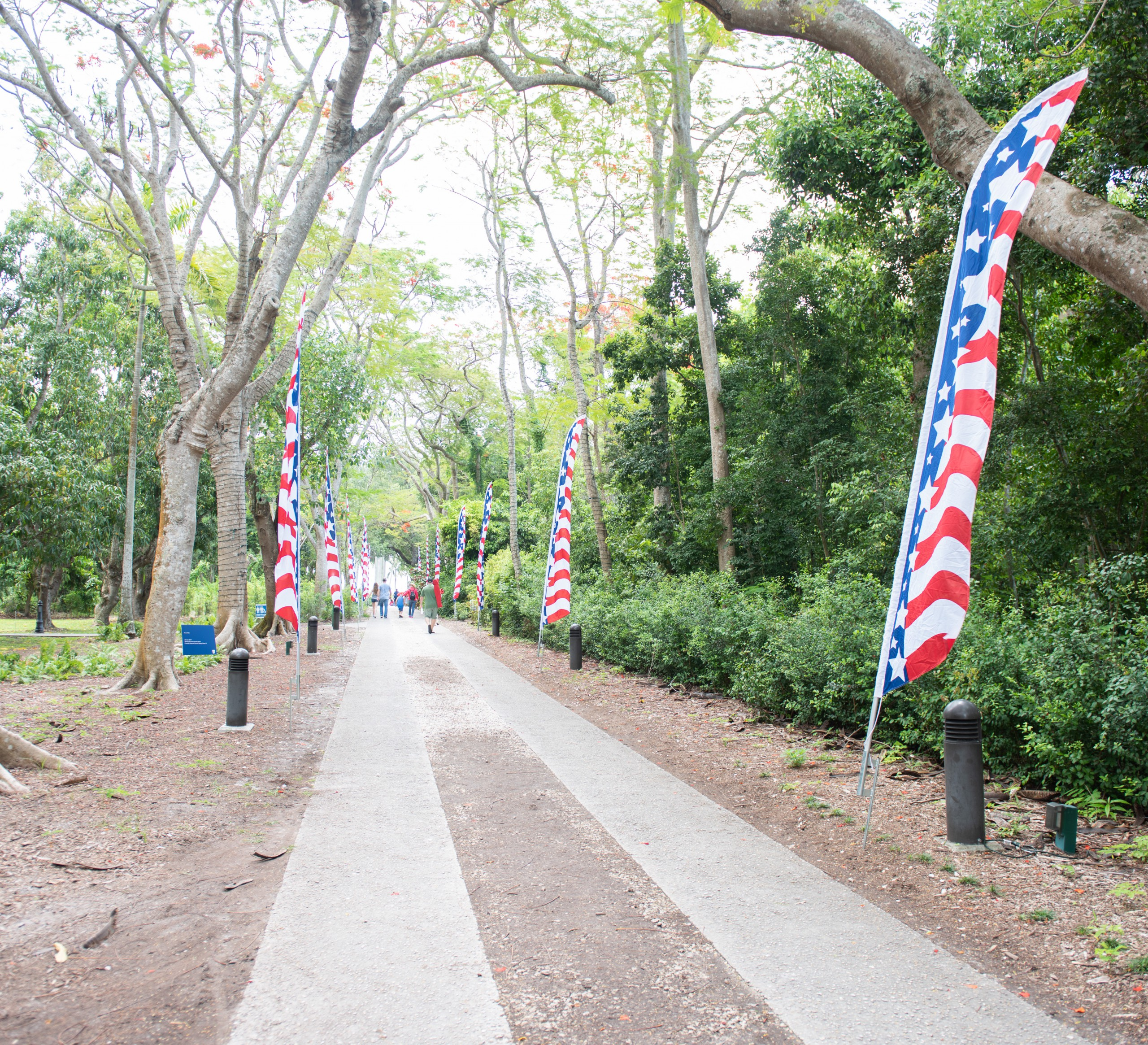 Main pathway of Deering Estate decorated for Memorial Day