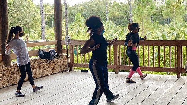 Afro-Fusion dance class taking place in the Visitor Center Breezeway