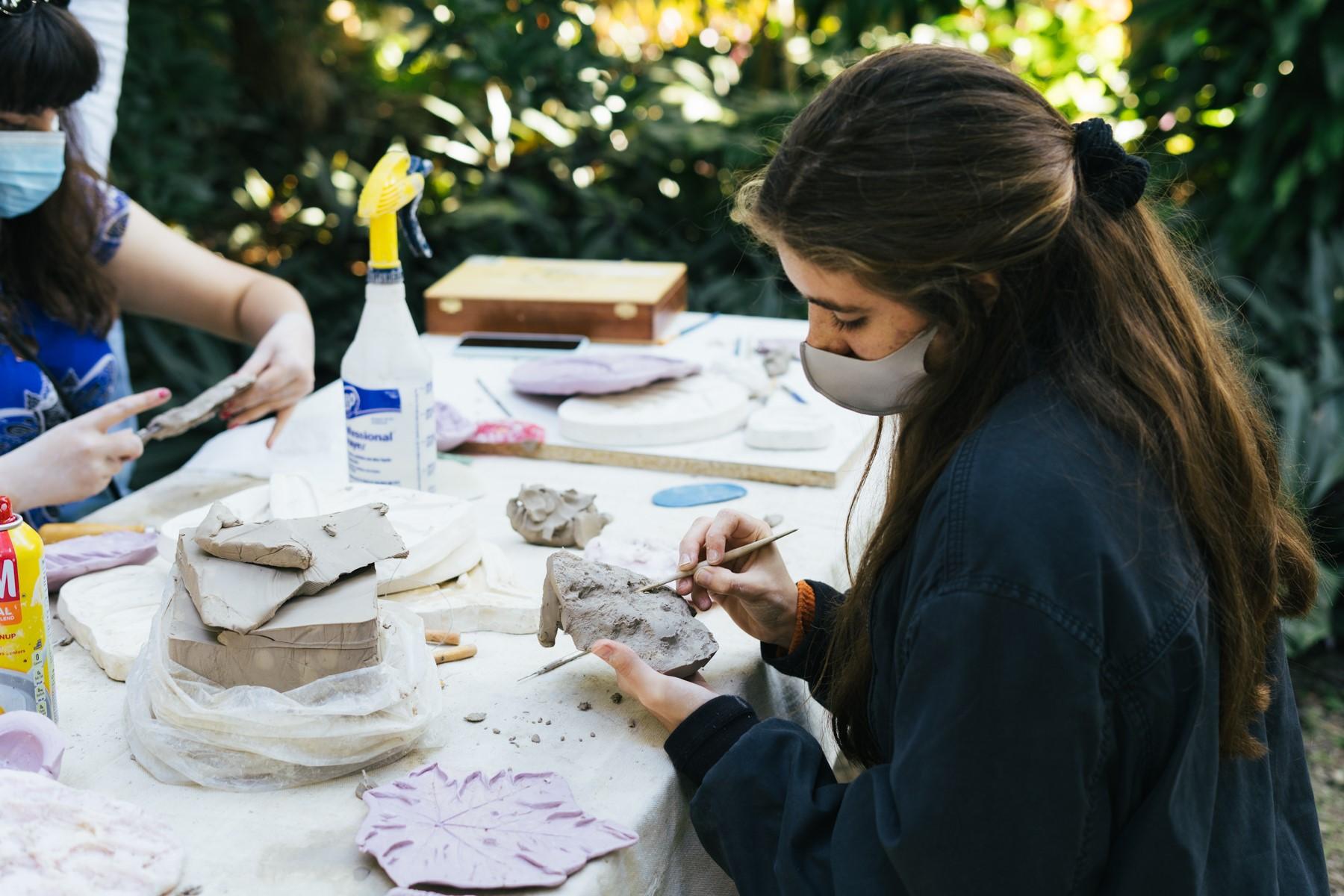 Student participating in Lauren Shapiro's community sculpting class