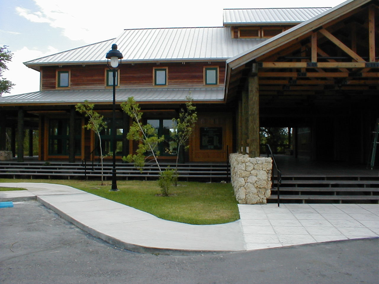 Frontal view of the Visitor Center from the parking lot