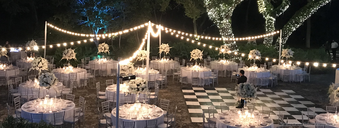 photo of a reception at Deering Estate's historic Courtyard. The couple is admiring their reception area during this reception-reveal.