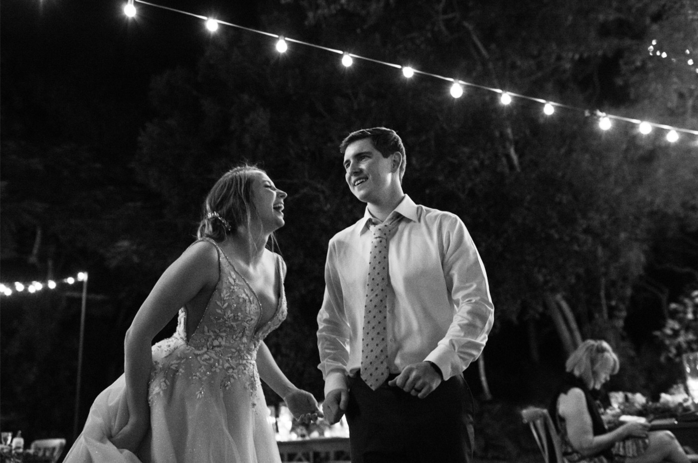 bride and groom laughing at there outdoor miami wedding reception
