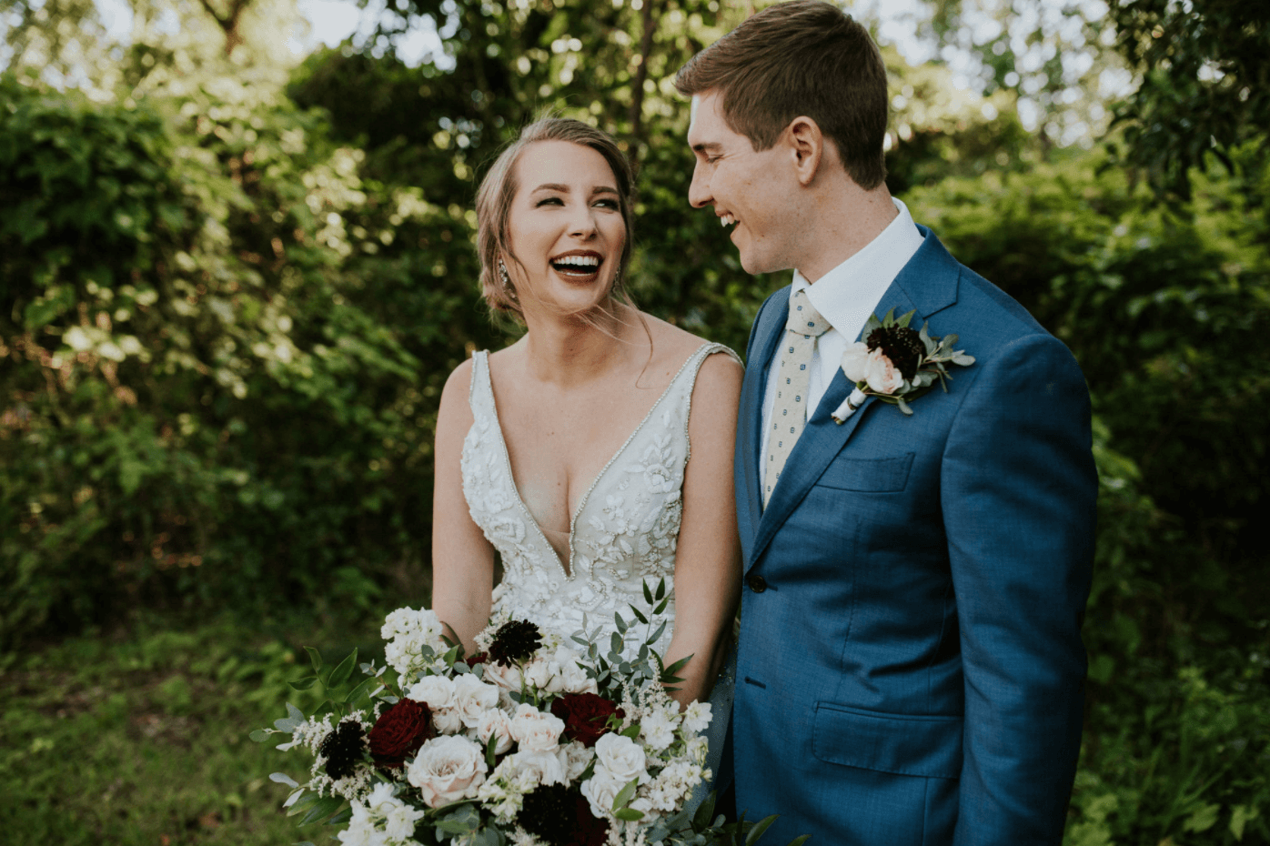 bride and groom laughing at miami outdoor waterfront wedding
